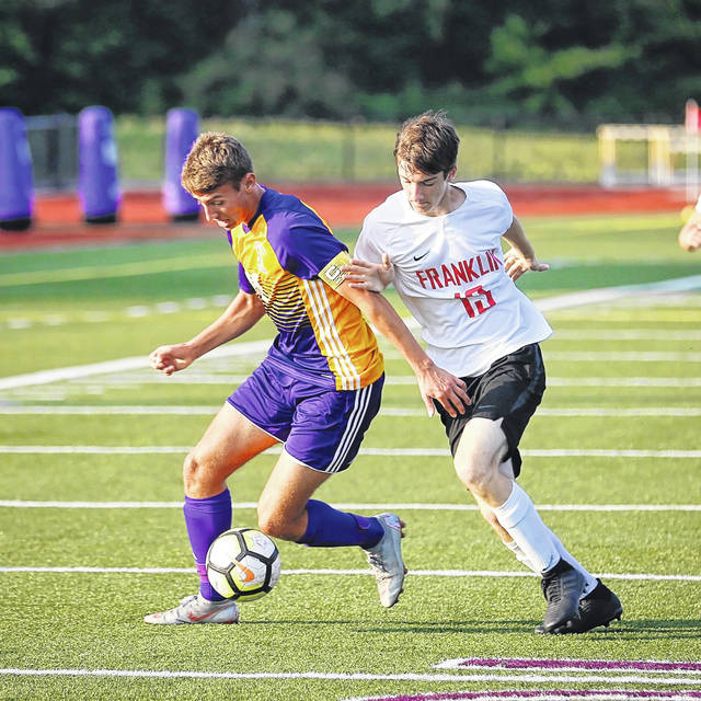 Eaton senior Owen Baumann gains control of the ball during the Eagles match with visiting Franklin on Thursday, Sept. 20. Eaton won the match 5-1.