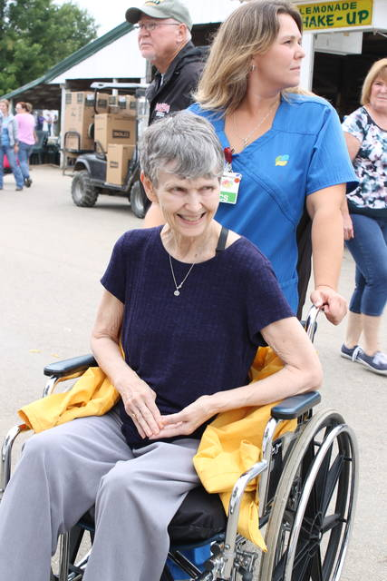 As Lydia Burnett traversed the fairgrounds, several people approached to say hello and offer hugs, filling the summer afternoon with ever more warmth.