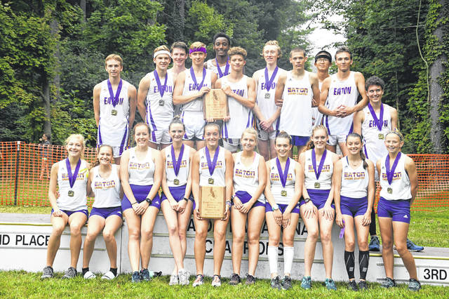 Eaton's boys and girls cross country teams celebrated winning team titles at the Eaton Invitational on Saturday, Sept. 15.