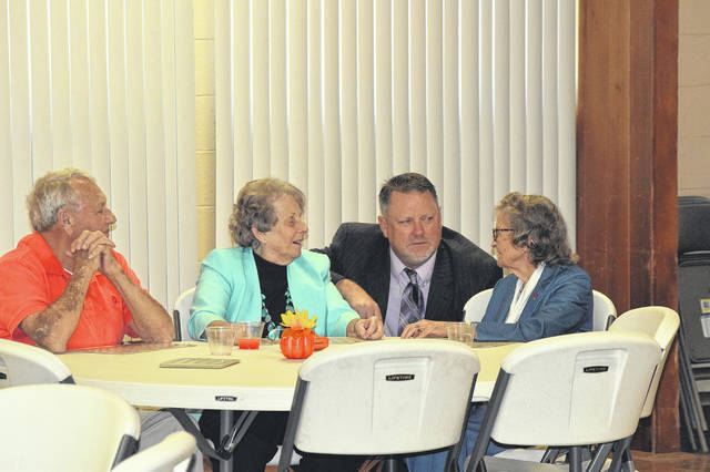 R-H Editor Eddie Mowen Jr. speaks with some of the couples who attended Tuesday's celebration. Many have attended for most of the 28 years the annual event has been held.