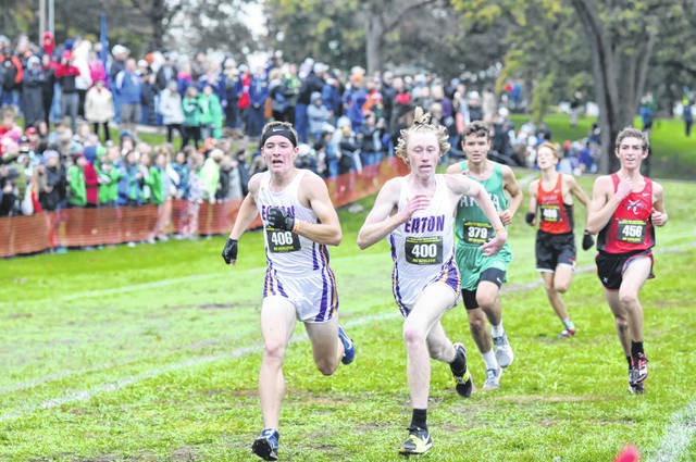 Eaton's Dylan Suding (left) and Jack Bortel near the finish line during the Division II regional championships on Saturday, Oct. 27, at Troy. Bortel and Suding finished 27th and 28th to help the Eagles earn a trip back to the state championships.