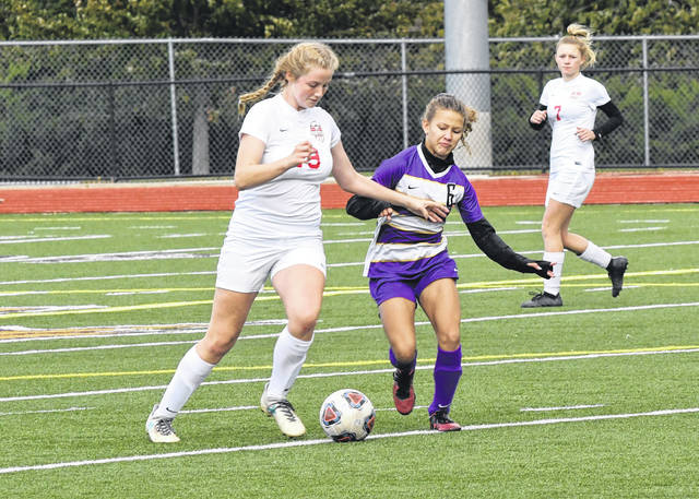 Eaton freshman Amyah Thacker battles a Madison player for possession during a second round sectional tournament game on Saturday, Oct. 20. Thacker scored a goal early in the first half to help Eaton to a 1-0 win and trip to the Division II sectional final against Alter.