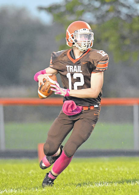 National Trail quarterback Evynn Short prepares to pass during the Blazers home game with Ansonia on Friday, Oct.5. Trail rallied from a double-digit deficit, but came up short, 20-17.