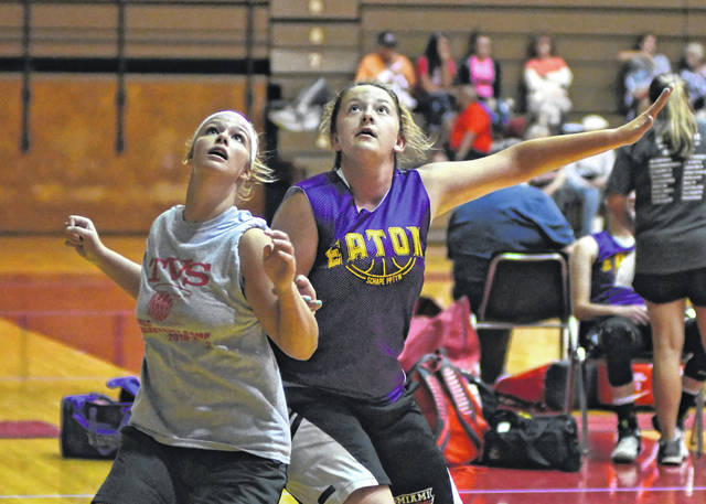 Twin Valley South's Mackenzie Neal (left) and Eaton's Becca Mowen battle for position during a summer league basketball game at Richmond (Ind.) High School. The two teams will meet at Eaton on Friday, Nov. 16 for a preview of the 2018-19 season.