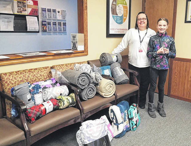 Ava Buchholz donated 22 blankets to the Preble County homeless shelter on Tuesday, Dec. 18. She intends to name this project Ava's Gift and grow each year, hoping eventually to be able to donate 100 blankets to the shelter.