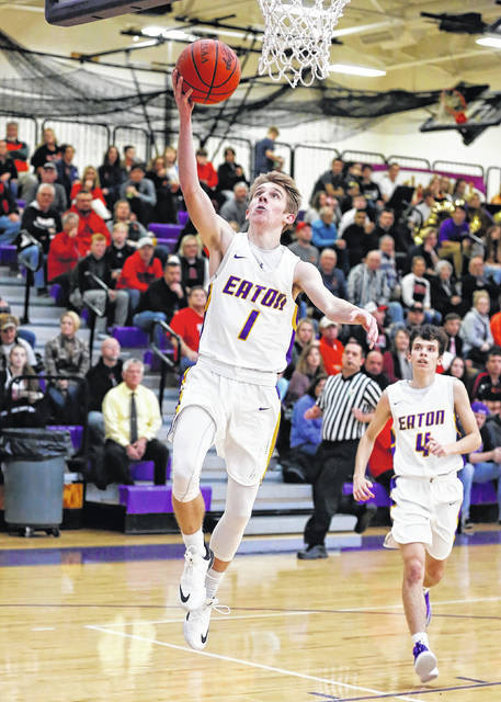 Eaton senior Isaac Manning drives for two of his 13 points during the Eagles contest with visiting Preble Shawnee on Tuesday, Dec. 4. Eaton held the lead for most of the game, but fell to the Arrows, 51-46.