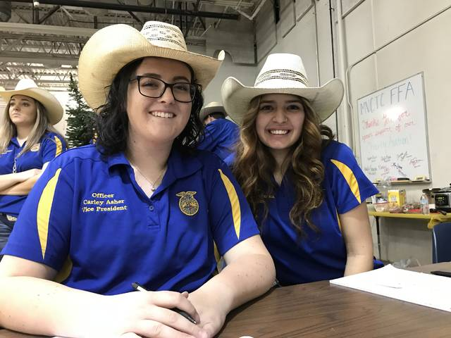 The MVCTC FFA raised over $8,500 during the 38th Annual Charity Auction for the Ronald McDonald House Charities of Dayton. Pictured left to right are MVCTC FFA Chapter Officers working at the event – Carley Asher (Preble Shawnee) and Trinity Konwiczka (Mississinawa Valley).