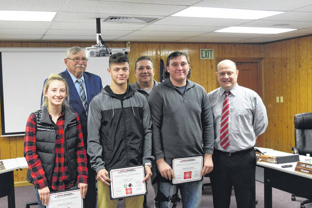 Students from all different organizations were recognized during the Preble Shawnee board meeting on Thursday, Nov. 29. Tyler Stevenson, Austin Tutt, and Michelle Bulach posed with the board after they were recognized for their recent accomplishments.