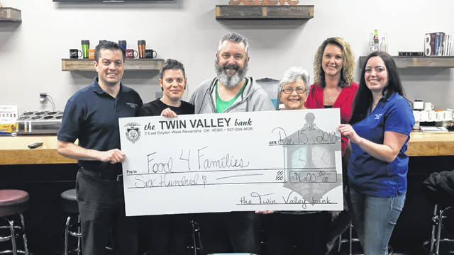 Twin Valley Bank donated $600 to Food 4 Families. Pictured are (left to right) Landen O'Banion (Twin Valley Bank), Jessica Maxel, Troy S Maxel, Dianna Thomas (Food 4 Families), Chrissy Bahnweg (Twin Valley Bank) and Jamie Gilvin (Twin Valley Bank).