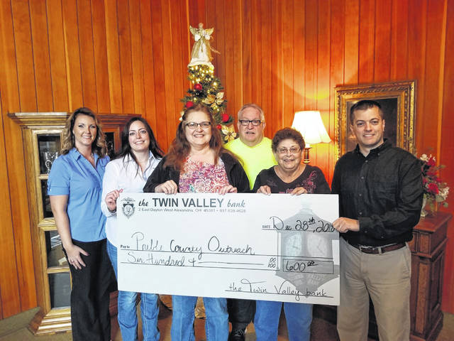 Twin Valley Bank recently donated $600 to Preble County Outreach. Pictured are (left to right) Chrissy Bahnweg and Jamie Gilvin (Twin Valley Bank), Carla Barnett and Roger Stine (Preble County Outreach) and Landen O'Banion (Twin Valley Bank).