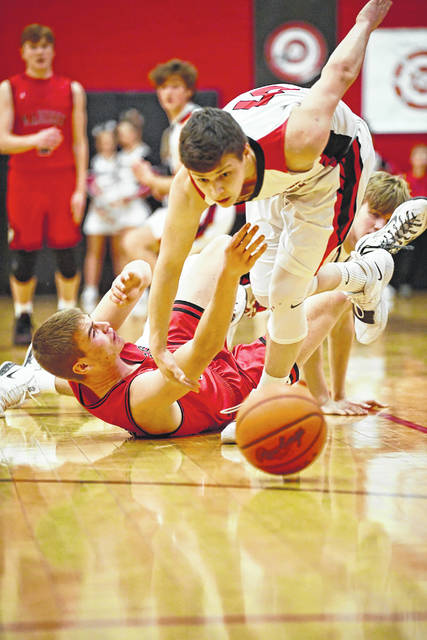 Preble Shawnee's Calvin Leeth scrambles to pick up a loose ball during the Arrows game with Madison on Friday, Jan. 11. Shawnee lost the match up of the SWBL Buckeye Division's top two teams, 80-51.