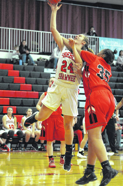Preble Shawnee's Logan Hollon gets fouled as she attempts a shot during the Arrows game with Northridge on Saturday, Feb. 2. Hollon scored seven points to help Shawnee to a 68-25 win.