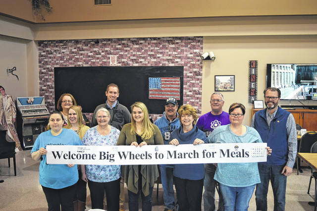 """Every year to celebrate March for Meals, PCCOA holds """"Big Wheels Week,"""" a week when prominent individuals from the community and county ride along with Home Delivered Meals drivers to deliver meals to local seniors."""