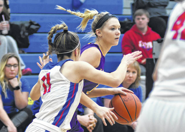 Eaton junior Bailey Shepherd is pressured by a Carroll player during the first half of a district semifinal game on Monday, Feb. 25, at Springfield High School. The Eagles had their season come to an end with a 65-30 setback.