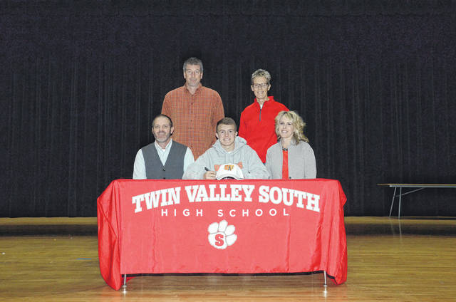 Twin Valley South senior Nathan Osborn (middle front) will continue his golf and academic careers at the University of Findlay in the fall.