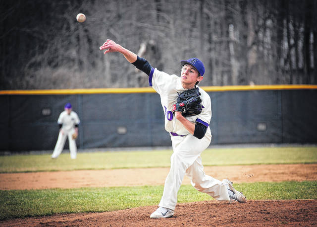 Eaton senior Owen Baumann delivers a pitch during a recent game. The Eagles picked up two wins over Oakwood last week, before dropping a pair of non-league games to end the week.