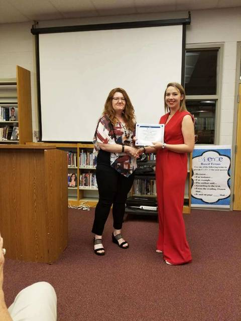 Megan Herbert, a soon-to-be-graduate of Tri-County North High School, was awarded this year's Preble County Chamber of Commerce Scholarship. Executive Director Leslie Collins (left) presented Herbert the award during the TCN Senior Award Ceremony held on Thursday evening, May 22 at the high school.