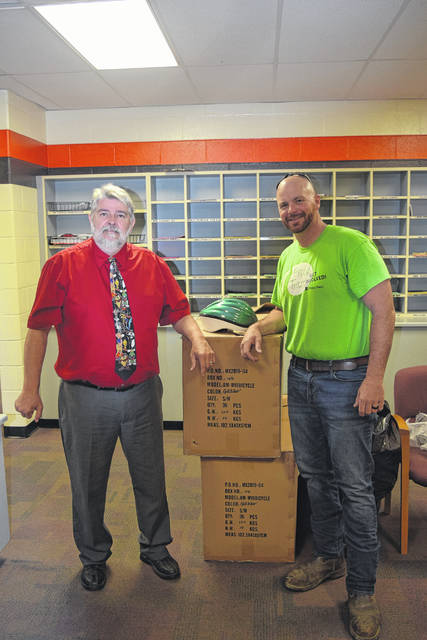 Preble Trails has also provided all Preble County school districts with free helmets for their second graders. Pictured above is National Trail Elementary Principal Ed Eales (left) and Preble Trail Chairman Dan Schmidt (right).
