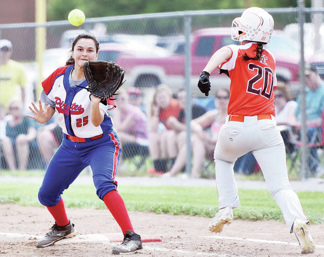 Riverside's Kalin Kreglow waits for the ball as National Trail's Makena Laird runs towards first at Tipp City on Saturday. Laird was called safe on the close play.