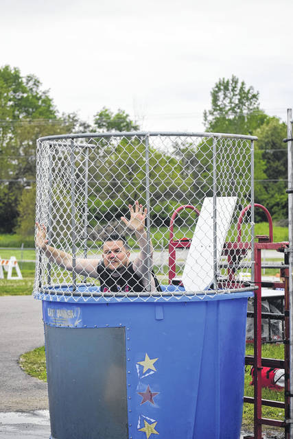 Superintendents from Preble County school districts spent time being the volunteers at the dunk tank during the fair.