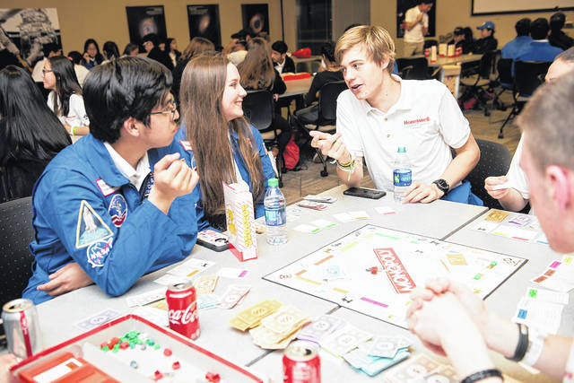 Game night on Day 1 of Week 1 of the Honeywell Leadership Challenge Academy (HLCA) at the U.S. Space and Rocket Center (USSRC) in Huntsville, Ala. on Sunday, Feb. 24, 2019.  Ambassador Izac Salazar (Escobedo, Mexico) Addie Bell (Eaton, OH) Olivier Hoogendorp (Putten, Netherlands. Team Inspiration)
