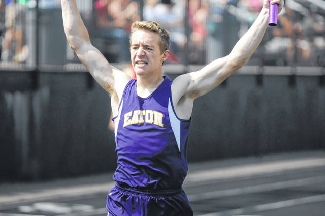 Eaton's Dylan Suding celebrates after he crosses the finish line in the 4x200 relay. The Eagles placed fourth in the event to qualify to next week's regional meet.