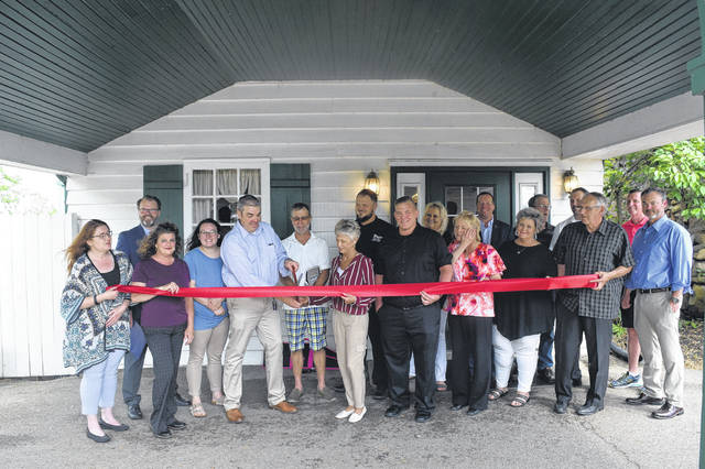 The Stone Chimney Tavern, a new restaurant open to the public, held its grand opening on Thursday, May 23 with a ribbon cutting sponsored by the Preble County Chamber of Commerce.