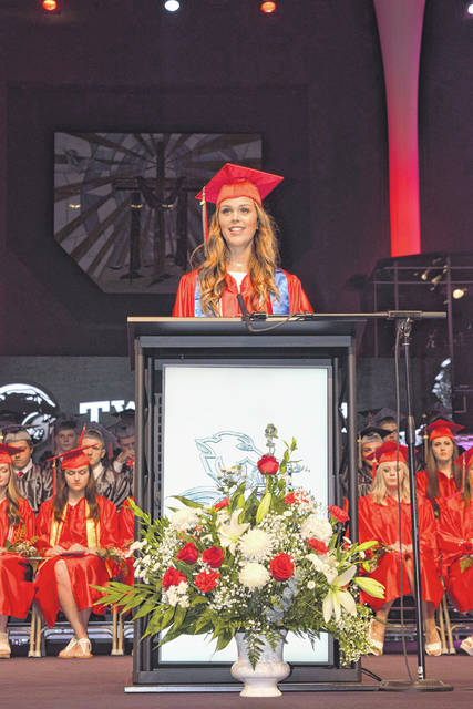 Class President Madison Blair welcomed guests and led the crowd in prayer.
