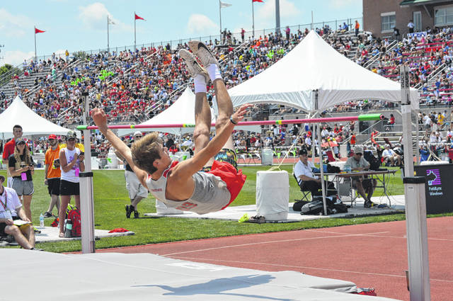 Twin Valley South's Jayden Bassler clears the bar at 6 feet during the state high jump competition on Friday, May 31.