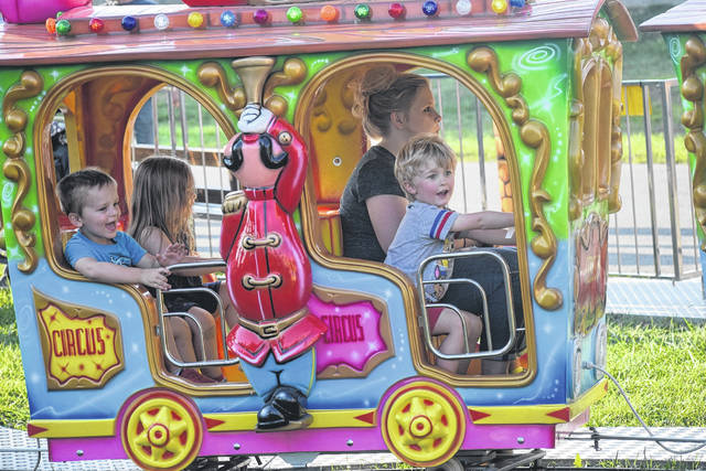 The 169th Preble County Fair kicked off on Saturday, July 27, without the traditional parade, but with a special opening ceremony honoring veterans and celebrating the fair. Pictured, a few kids enjoy a ride during the opening weekend of the fair.