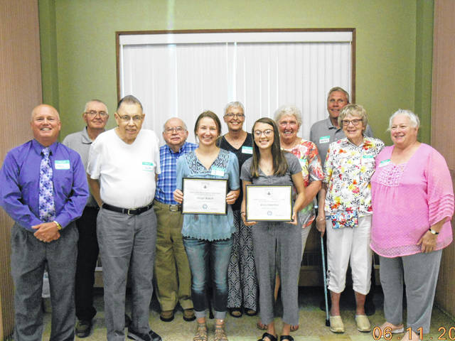 During the June 11 Preble County Retired Teachers Association (PCRTA) meeting, President Harold Niehaus presented certificates to the PCRTA scholarship recipients, Abigail Bulach (Preble Shawnee) and Arica Hamilton (Eaton). Both girls are pursuing education careers.