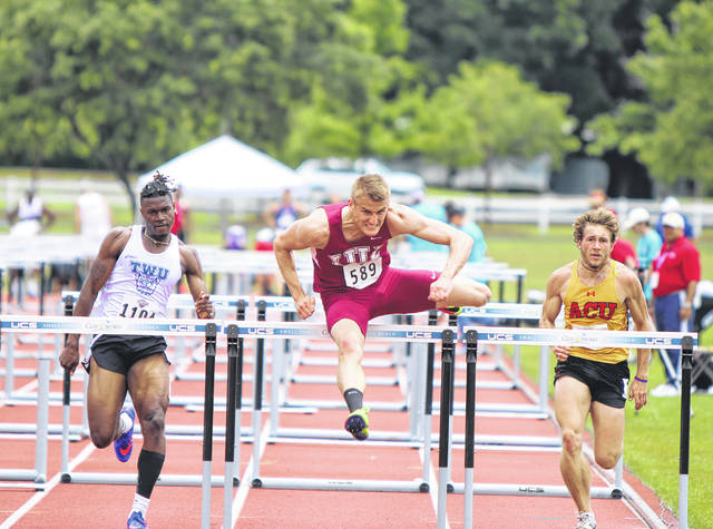 Seth Reynolds (center), an Eaton High School graduate, was recently named IU East Men's Athlete of the Year for the 2018-19 season
