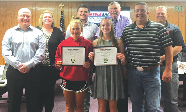 Preble Shawnee students Alivia Reek and Maggie Schmidt were presented certificates of achievement by the board of education for their performance at the Ohio High School Athletic Assocation (OHSAA)'s state track meet May 24.