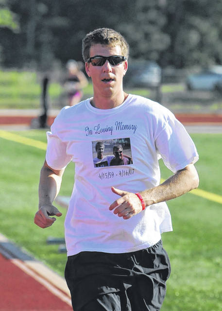 Blake Pieratt approaches the finish line during the 11th annual Ratt Race, held in honor of his dad, Steve, who died unexpectedly in September of 2007.