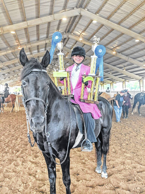 Hannah Farley placed first and Grand Champion in both Western Pleasure and Easy Gaited English Pleasure at the Ohio State Fair.
