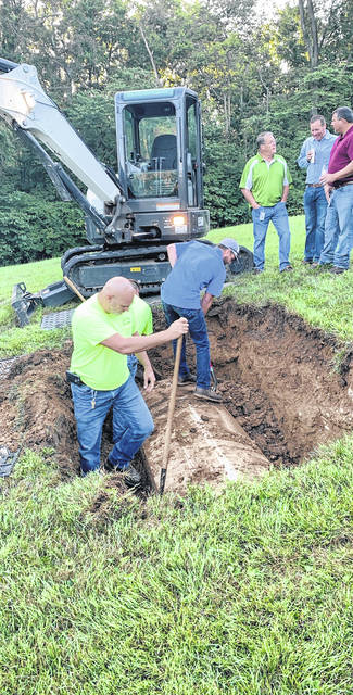 This morning the Preble County Coroner's Office worked with the Shelby Police Department and City of Eaton staff to exhume a body at Mound Hill Cemetery.