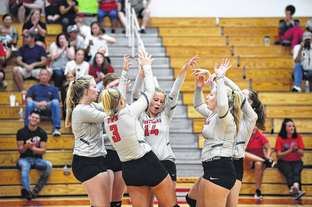 Members of Twin Valley South's volleyball team celebrates after scoring a point during its match with Stivers. South won the match in straight sets on Tuesday, Aug. 20
