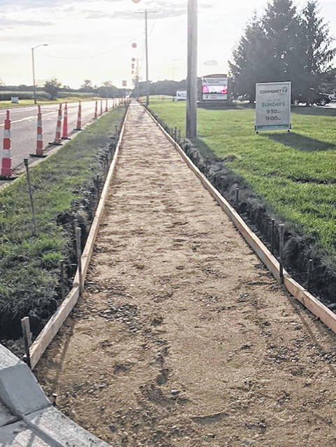 New sidewalk was installed on Washington Jackson Road in front of the YMCA and Kettering Health Network Facility, connecting to Seven Mile Park. Work was completed on the project on Friday, Sept. 6.