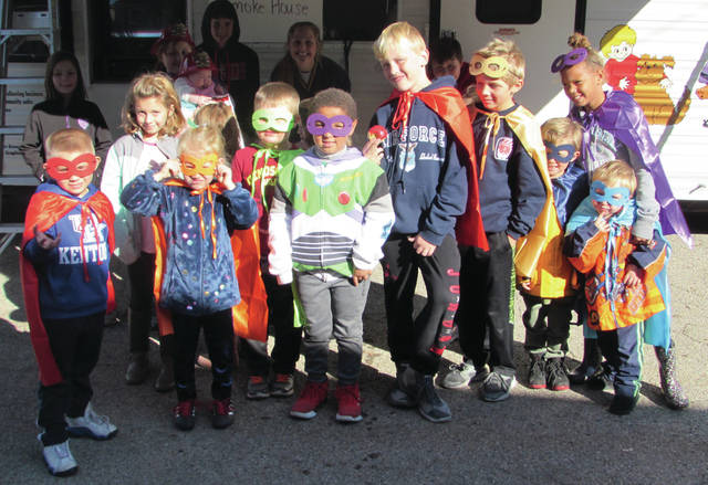 """The theme of the event was """"Not Every Hero Wears a Cape. Plan and Practice Your Escape!"""" Children present were dressed in colorful superhero-like costumes."""