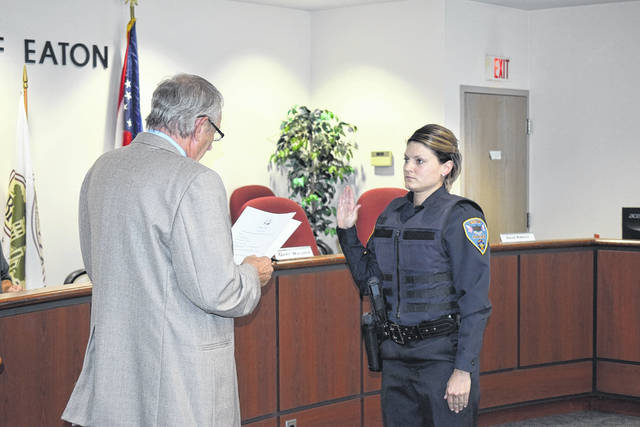 During the Eaton City Council meeting on Monday, Sept. 16, three officers were sworn into the Eaton Police Division. Pictured above is Sarah Rose being sworn in as patrol officer.