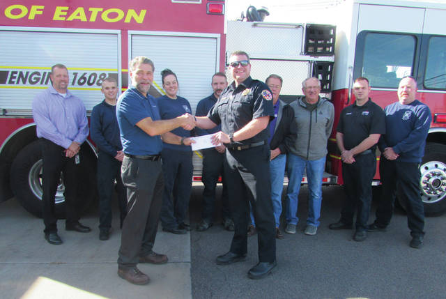 Timken Steel St. Clair Plant manager John Liddy presented Eaton Fire and EMS Chief Brian Smith with a check for $14,881 on Friday, Oct. 26. The funds will be used to purchase a LUCAS Chest Compression System, a device that delivers mechanical chest compressions to individuals experiencing cardiac arrest.