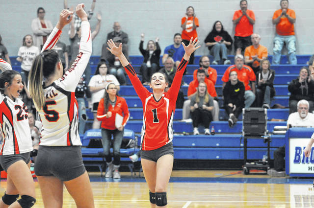 National Trail's Madison Hathaway (1), Angel Bowers (5) and Jenna Petitt (25) celebrate after the Blazers scored a point in the third set of their first-round sectional tournament game against Greeneview. Trail suffered a 25-13, 25-20, 28-26 loss to end its season.