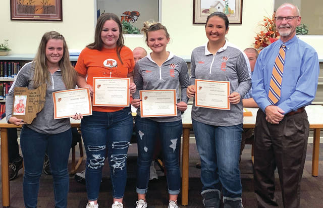 Members of the National Trail High School Golf Team (from left to right): Makenna Jones, Brooklyn Middleton, Katelyn Hines, and Caitlin Gilland, with Coach Gene Eyler.