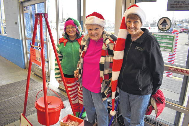 Salvation Army bell ringers are stationed in front of Eaton Walmart and Kroger until Dec. 24. However, what many don't realize is that 80 percent of those funds raised stay in Preble County to provide residents with assistance. Pictured above: bell ringer Chelley Rutherford (left), and bell ringer Jenny Eyer, and Preble County Kettle Coordinator Judy Barth (right).