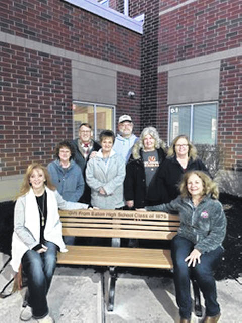 Members of the 1979 class of Eaton High School donated a park bench to the high school on Nov. 25 to commemorate the 40th anniversary their graduation. Pictured above (left to right): Rebecca (Duggins) Marker, Connie Frizzell, Brad Riley, Pam (Cullers) Boyd, Greg Taylor, Suzi (Ingram) Becker, Jane (Hayes) Mobley, and Gretel (Wikle) Johnston.