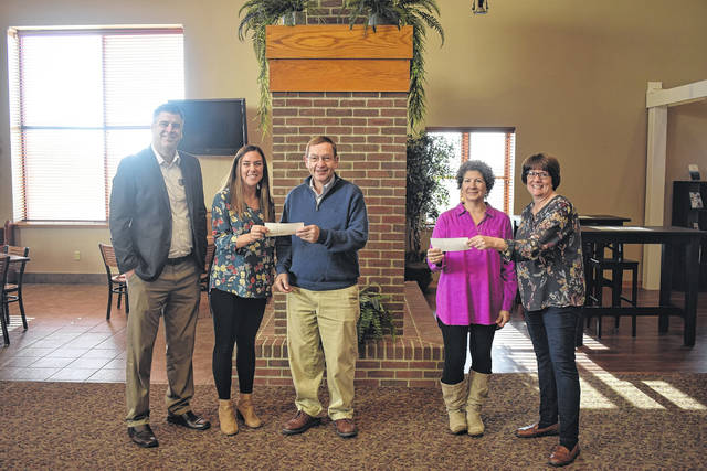 Eaton Community Church presented Home is the Foundation and Birthright of Eaton with a check on Tuesday, Nov. 26.