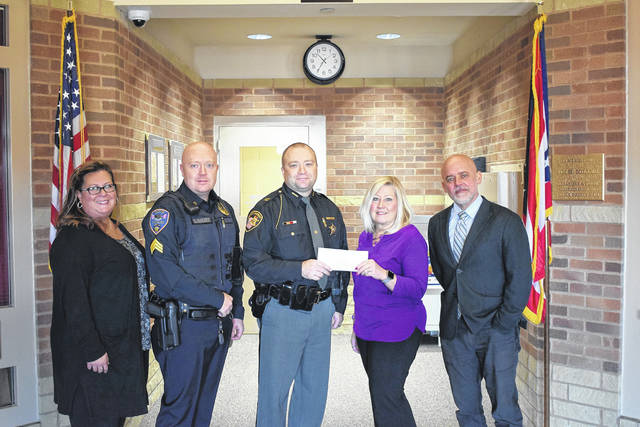 On Wednesday, Dec. 4, Preble County Victim Witness presented the Fraternal Order of Police, Floyd E. Spitler Lodge #158 with a check in the amount of $525 for its upcoming Cops & Kids event.