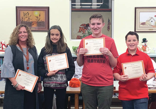 November 2019 Middle School Students of the Month Brooklynn Cheek, Grant Deaton, and Draken Utley, with principal Jen Couch.