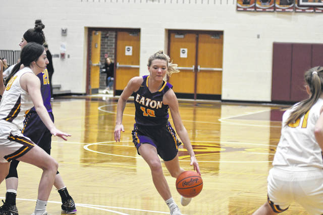 Eaton senior Bailey Shepherd drives to the basket during the Eagles game at Ross on Wednesday, Dec. 11. Eaton rallied from a slow start to earn a 34-27 win. She finsihed the game with 12 points, eight rebounds and four steals.