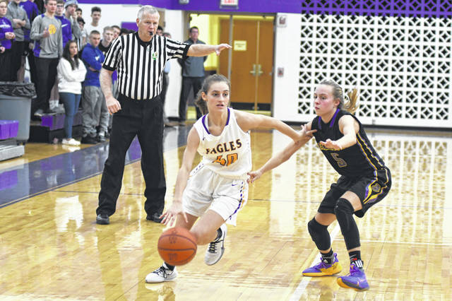 Eaton freshman Lily Shepherd drives to the basket during the Eagles game with Bellbrook on Thursday, Dec. 19. Eaton dropped a 46-45 decision.